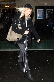 Sienna miller is seen in NYC fighting the cold and snow off. She kept super cozy with a black hooded tench coat and tan leather bag.