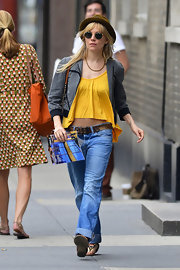 Sienna Miller topped off her unique eclectic style while out in NYC with this gray zip-up bomber.
