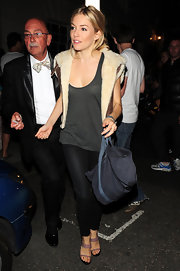 Sienna wore her 'Dok' vest over a gray tank while out and about in London.
