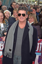 Tough man Simon Cowell hid his eyes with these super dark aviator shades.