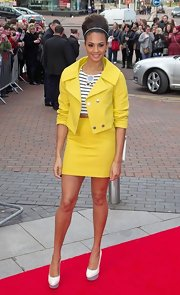 A pair of white pumps with gray platforms completed Alesha Dixon's cool ensemble.