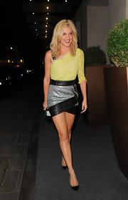 Ashley Roberts rocked a totally edgy look when she sported an asymmetrical dress with a yellow lace bodice and a leather-paneled skirt.