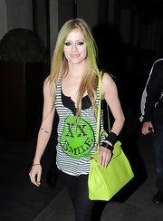 Avril Lavigne wasn't afraid of color while in London. The singer polished her nails with lime green nail polish, which matched her neon streaks.