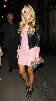 Carrie looked edgy and sweet in a pink lace dress and black leather jacket.
