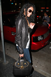 Ciara showed off her sleek style in a cool leather jacket. She carried a black studded leather tote to add even more edge to her ensemble.