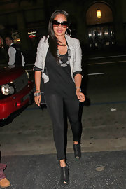 A pair of shiny black leggings infused some sexiness into La La Anthony's smart dinner outfit.