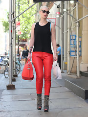 Iggy wasn't afraid to bring out her wild side with a pair of bright red leather pants.