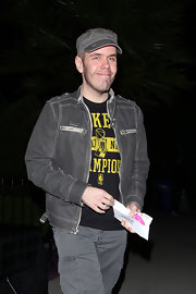 Perez Hilton looked hip during Prince's concert in a gray zip-up jacket and newsboy cap.