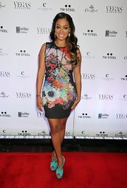 La La Anthony looked sweet and sexy at the same time in a curve-hugging floral dress during Vegas Magazine's anniversary party.