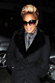 Mary J was seen out in London all cozied up in a fur trench coat. She recently opted for blonde highlights, which is a great color for her skin complexion.