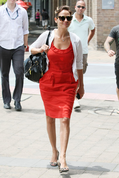 Natalie Imbruglia complemented her plain red dress with a pair of leopard-print wedges during a lunch date in Sydney.