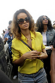 Rihanna sported a pair of over-sized round sunglasses while touring Rio.
