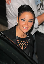 Bright purple eyeshadow gave Tulisa's peepers an impactful pop.