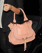 Alesha Dixon was out and about in London carrying this stylish pink leather tote.