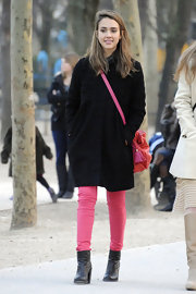Jessica Alba brightened up her black coat with hot pink jeans and a matching bag.