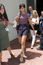 Freida Pinto looked summery and sweet at Comic-Con in a gingham seersucker romper teamed with cream espadrille wedges with crisscrossing straps.