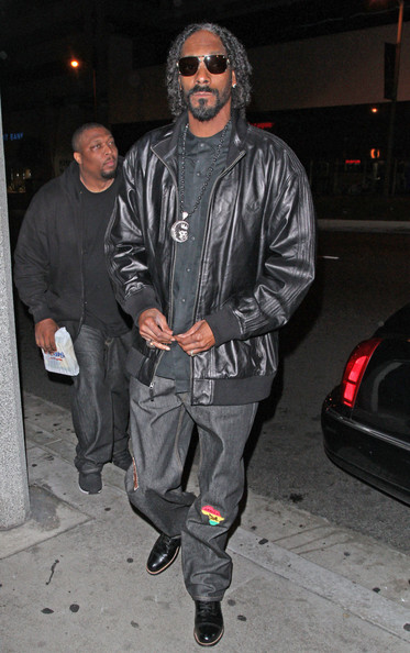 Snoop Dogg sported a casual black leather jacket for his evening look out in Hollywood.