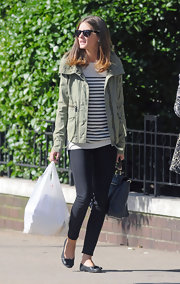 Olivia Palermo was casual chic while out and about in NYC. The fashion maven donned a striped tee paired with classic black flats.