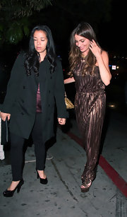 Sofia Vergara stepped out in a metallic maxi dress for her evening look.
