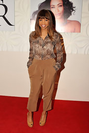 Elise Neal kept her style sophisticated and classy with a print blouse and wide-leg pants at the Le Posh Nail Spa event in LA.