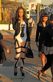 Tami Roman paired a loose printed blouse with skinny pants and a black blazer for a casual yet dressy look.