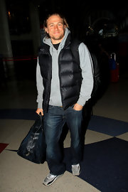 Charlie Hunnam chose a black puffer vest to pair over a hoodie while out traveling in LA.