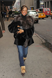 Stacey Dash strolled through town in cozy looking shearling boots.