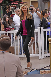 Stacy Keibler was chic in black and pink on the set of 'Extra.' She topped off her look with light gray pumps.