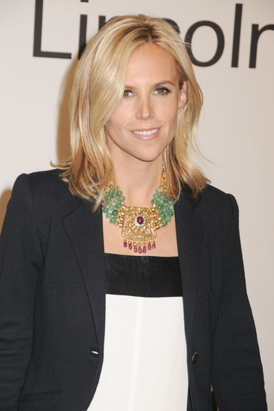Tory Burch wore an 18-carat yellow gold and platinum necklace with diamonds, rubies and emeralds at an evening with Ralph Lauren hosted by Oprah Winfrey.