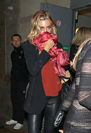Abbey Clancy tried to hide behind a patterned red scarf as she left the Lingerie London event.