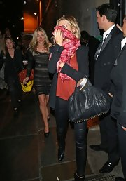 Abbey Clancy was spotted leaving the Lingerie London event carrying a black leather tote.