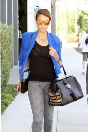 Jessica Alba carried her amazing Cobra Society handbag as she stopped for some lunch before heading to work in Los Angeles.