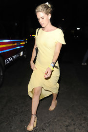 Alice Eve looked lovely in yellow when she attended Mick Jagger's birthday bash in this creamy yellow frock.