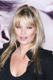 Kate Moss showed off her long straight cut and blunt cut bangs while launching her vintage Muse perfume in London.