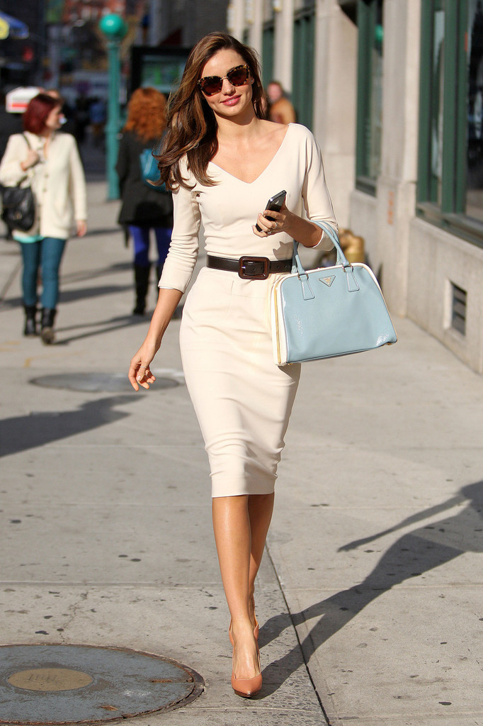Supermodel Miranda Kerr goes glamorous in a white sleeved dress and black belt, as she goes out and about in New York City.