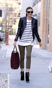 Miranda Kerr was ultra chic while out and about in Manhattan. The Australian beauty paired her nautical-inspired top with black ankle boots complete with bold buckled detailing.