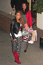 Edgy but cute, Jesy Nelson's hot pink lace-up boots added a bright pop of color to her black-and-white outfit.
