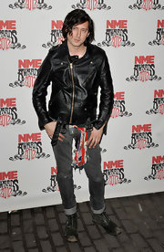 Carl Barat arrived at the NME Awards and looked awesome in an asymmetrical black leather jacket with gold hardware.