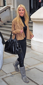 Tara Reid kept it cozy while out in London. She paired her casual outfit with a soft gray sheepskin boots.