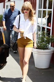 "Taylor Swift stepped out for a coffee in LA wearing a pair of cool cat eye ""Benedict"" sunglasses."