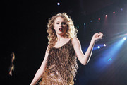 Taylor Swift performs in a glittering gold frock at the Mediolanum Forum in Milan. The Grammy-winning singer is in Italy as part of her 'Speak Now' World Tour 2011.