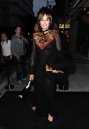 Yasmin Le Bon wore this floor-length black gown with a vibrant feathered neck piece.