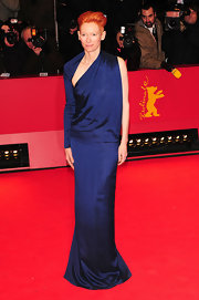 Tilda is stunning at the Berlinale Film Festival in an asymmetric modern navy blue evening gown
