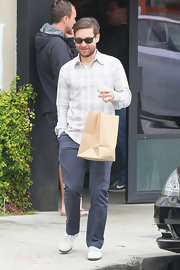Toby Maguire stepped out sporting a classic plaid button down while hanging out with friends in LA.