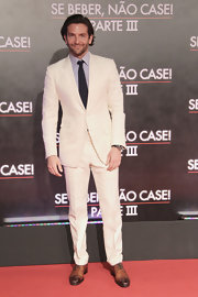 Bradley looked stylish as ever in this summery white two-button suit.