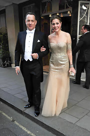 Tom Hanks and Rita Wilson put on the glam for their visit to Buckingham Palace with the President and First Lady. Tom was decked out in tails while Rita sparkled in a Monique Lhuillier from her Spring collection. The glittering tulle confection was the perfect choice for the romantic occasion.