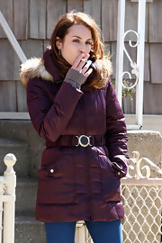 Noomi Rapace kept warm with a plum-colored down jacket while filming 'Animal Rescue' in Brooklyn.