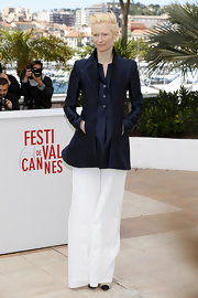 Tilda Swinton chose this structured navy blazer to pair with wide-leg trousers for a chic masculine-inspired look at Cannes.