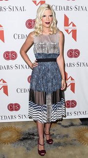 Tori Spelling chose this patchwork-style dress with a pleated skirt for her look while attending a Mother's Day Luncheon in LA.