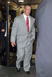 "John Cena looks like he belongs in the ""Goodfellas"" in this gray pinstriped suit. A burgundy tie makes for a great color contrast."